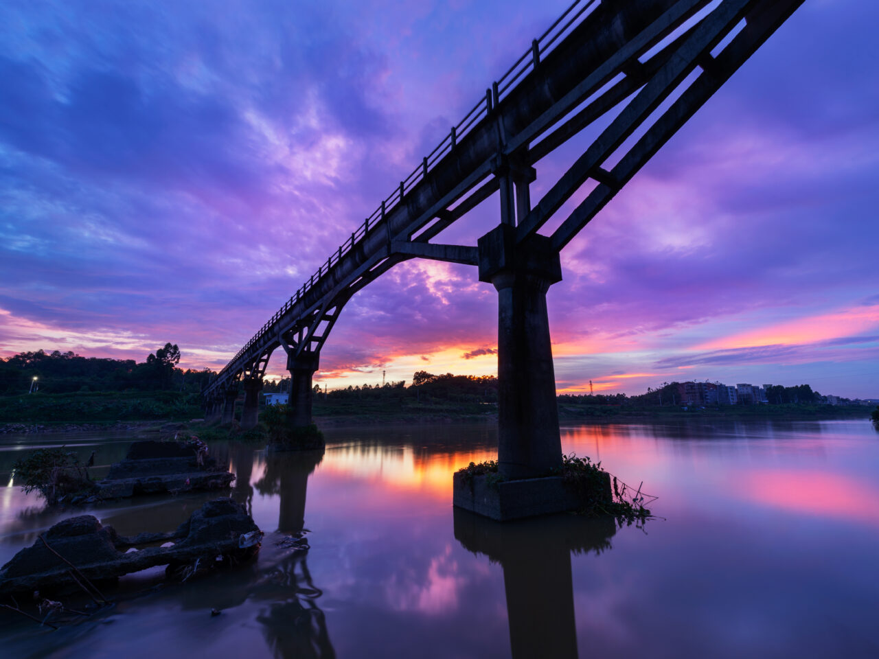 Dusk view of the bridge over the river